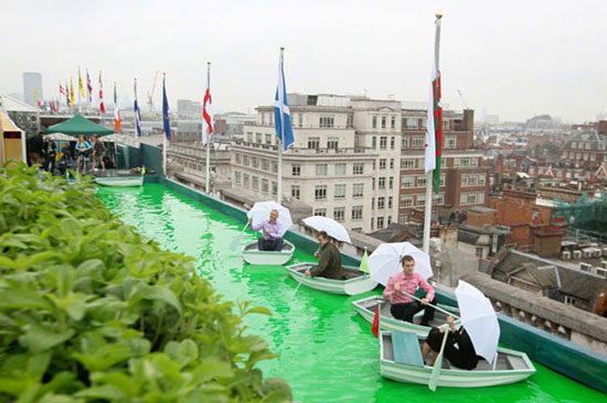 (Left to right) Tony Lucas, Sam Bompas, Mark Brookes, and Zenna McFerson afloat on a boating lake on the roof of Selfridges, in central London, which is opening its roof to the public for only the second time since World War II to show the Truvia Voyage of Discovery installation by food architects Bompas and Parr.